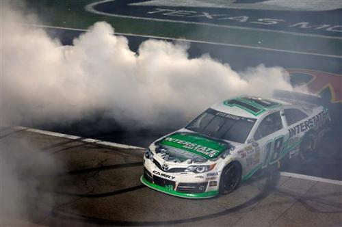 Kyle Busch performs his burnout after officiously showing his talents on Saturday night.