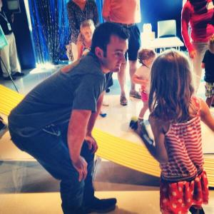 A little asks Austin Dillon how to make her Pinewood Derby car faster than his. (Credit: Kristen Schneider)
