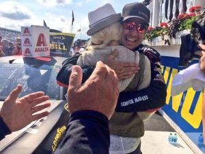 Martin Truex Jr. hugs girlfriend Sherry Pollex after winning the Axalta 400 at Pocono Raceway. (Credit: @NASCAR on Twitter)